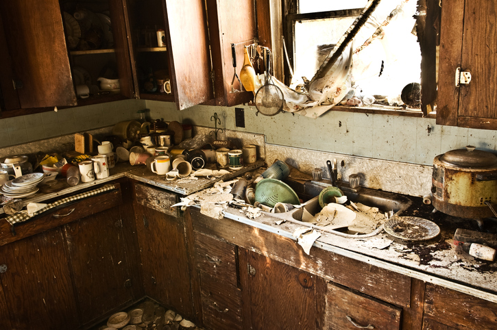 A messy kitchen and unappealing house in Fort Lauderdale.